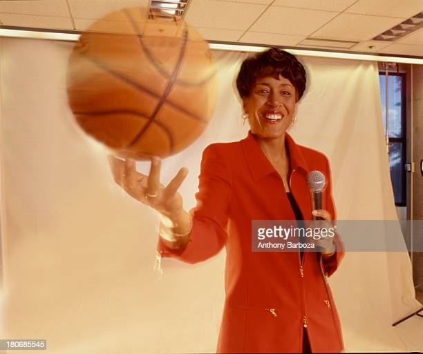Portrait of American broadcast journalist Robin Roberts as she poses with a basketball in one hand and a microphone in the other New York New York...