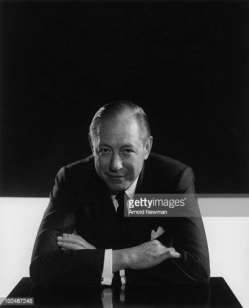 Portrait of American broadcast network executive president of CBS radio and founder of CBS television William S Paley as he poses in a CBS board room...