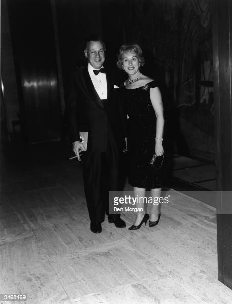 Portrait of American business executives and beauticians, married couple Joseph Lauder and Estee Lauder dressed in formal attaire, mid 1960s.