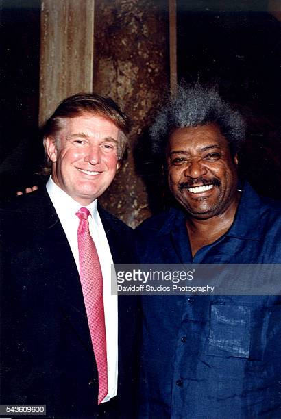 Portrait of American businessman Donald Trump and boxing promoter Don King as they pose together at the MaraLago estate Palm Beach Florida 1999