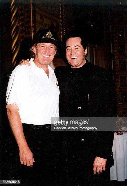 Portrait of American businessman Donald Trump and musician Wayne Newton as they pose together at the MaraLago estate Palm Beach Florida 1997