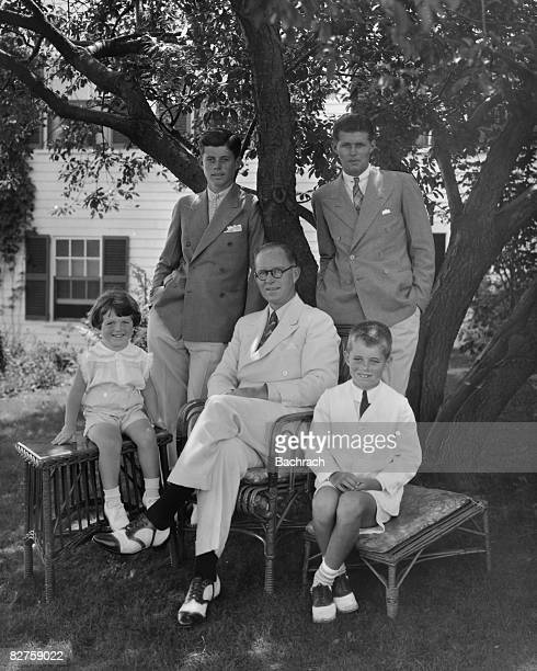 Portrait of American businessman Joseph P Kennedy Sr as he poses with his sons around him, clockwise from left, Edward Kennedy, John F Kennedy ,...