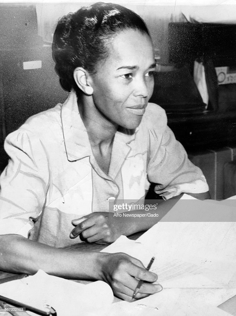 A photograph of Miss Ella Baker, NAACP Hatfield representative, sat behind a desk with paperwork, September 18, 1941.