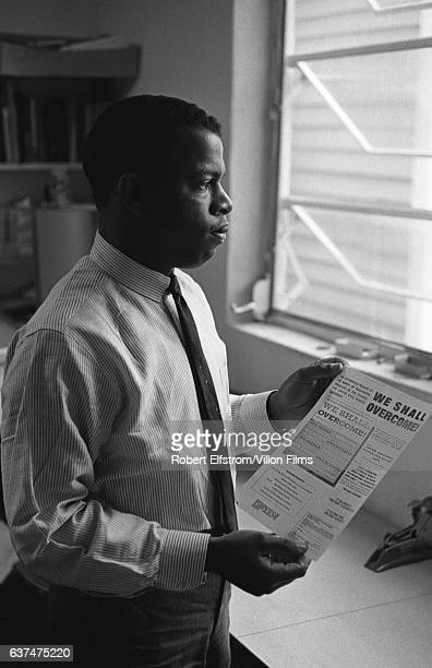 Portrait of American Civil Rights activist John Lewis, chairman of the Student Non-Violent Coordinating Committee , in an office, New York, 1964. He...