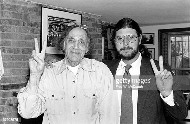Portrait of American Civil Rights activists and lawyers William Kunstler and Ron Kuby as they make 'peace' signs and pose in their office New York...