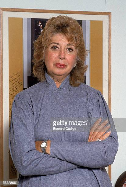 Portrait of American coloratura opera singer and general director of the New York City Opera Beverly Sills who stands with her arms crossed in front...