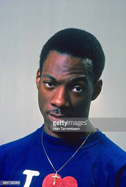Portrait of American comedian and actor Eddie Murphy in his bedroom at his mother's house Hempstead Long Island New York January 15 1982