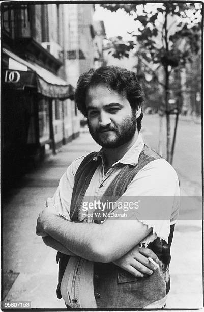 Portrait of American comedian and actor John Belushi as he he stands on a street in Manhattan's Greenwich Village New York New York July 14 1975