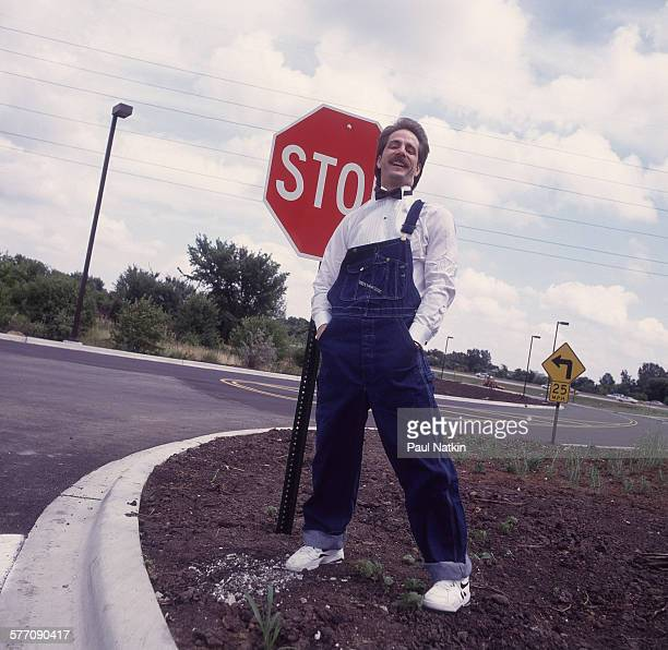Portrait of American comedian Jeff Foxworthy as he poses beside a stop sign on the side of the road Chicago Illinois July 12 1993