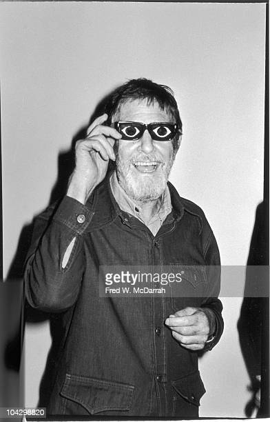 Portrait of American composer John Cage as he tries of a pair of joke eyeglasses and laughs New York New York October 14 1977