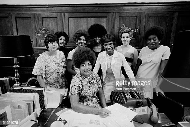 Portrait of American Congresswoman Shirley Chisholm as she poses with her staff in her woodpanelled office Washington DC 1970