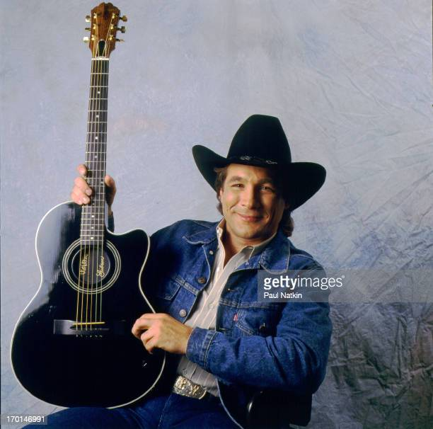 Portrait of American country musician Clint Black as he poses with his guitar Chicago Illinois July 22 1990