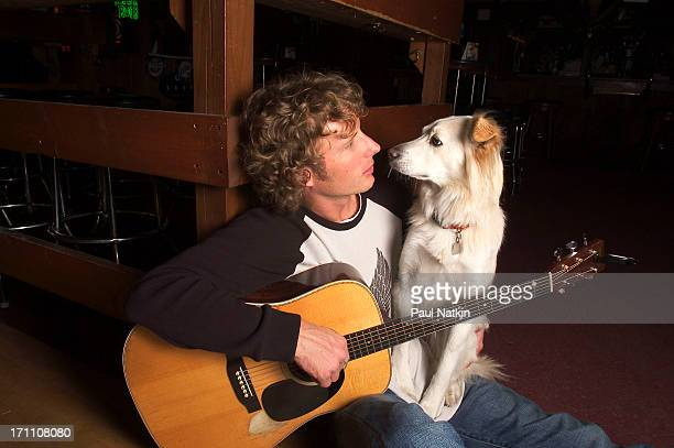 Portrait of American country musician Dierks Bentley and his pet dog Chicago Illinois December 6 2003