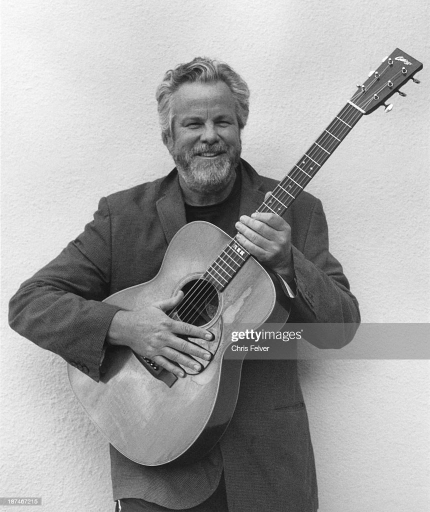 Portrait of American Country musician Robert Earl Keen as he poses with his acoustic guitar, Mill Valley, California, 2013.