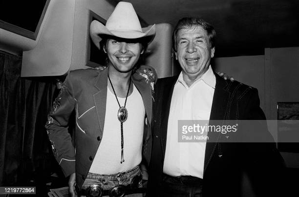 Portrait of American Country musicians Dwight Yoakam and Buck Owens as they pose backstage at the Chicago Theater, Chicago, Illinois, August 5, 1988.