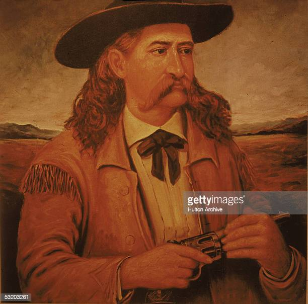 Portrait of American cowboy scout professional gambler and gunfighter Wild Bill Hickok as he wears a fringed leather jacket and holds a revolver...