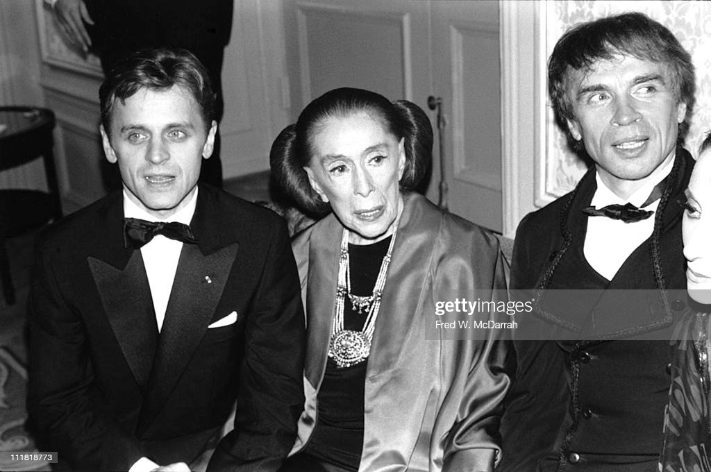 Portrait of American dancer and choreographer Martha Graham (1894 - 1991) (center), flanked by Russian-born dancers Mikhail Baryshnikov (left) and Rudolf Nureyev (1938 - 1993), at an event in her honor, New York, New York, October 6, 1987.