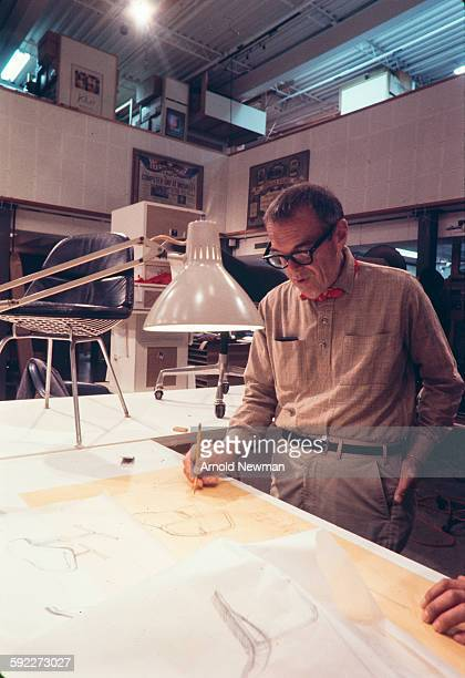 Portrait of American designer Charles Eames as he works on a drafting table in his studio Venice California November 16 1974 This photo was taken as...