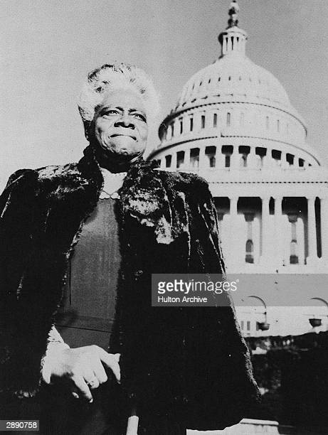 Portrait of American educator and activist Mary McLeod Bethune with the United States Capital Building in the background circa 1950