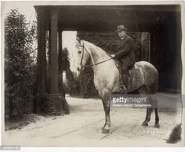 Portrait of American educator Booker T Washington president of the Tuskegee Institute astride his horse Dexter ca 1915