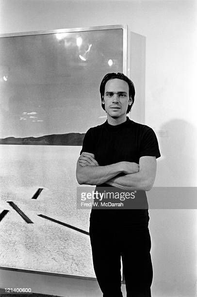 Portrait of American environmental artist Michael Heizer as he poses next to one of his pieces at an exhibition New York New York October 10 1968