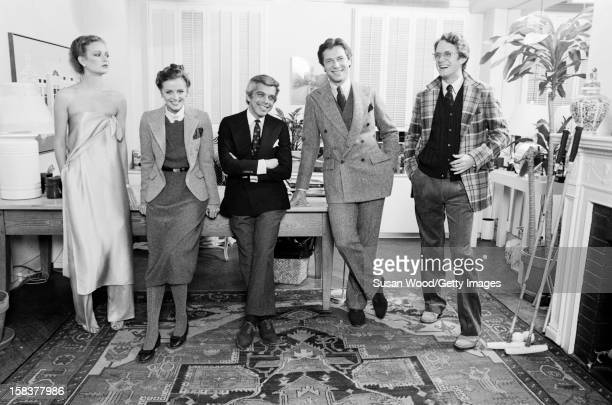 Portrait of American fashion designer Ralph Lauren along with unidentified staff members and models in his 7th Avenue office with staff and models...