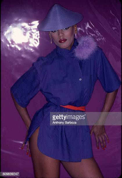 Portrait of American fashion model Toukie Smith as she poses against a purple background New York New York early 1980s