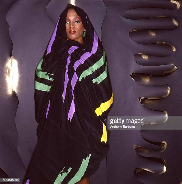 Portrait of American fashion model Toukie Smith as she poses wrapped in a dark multicolored robe New York New York early 1980s