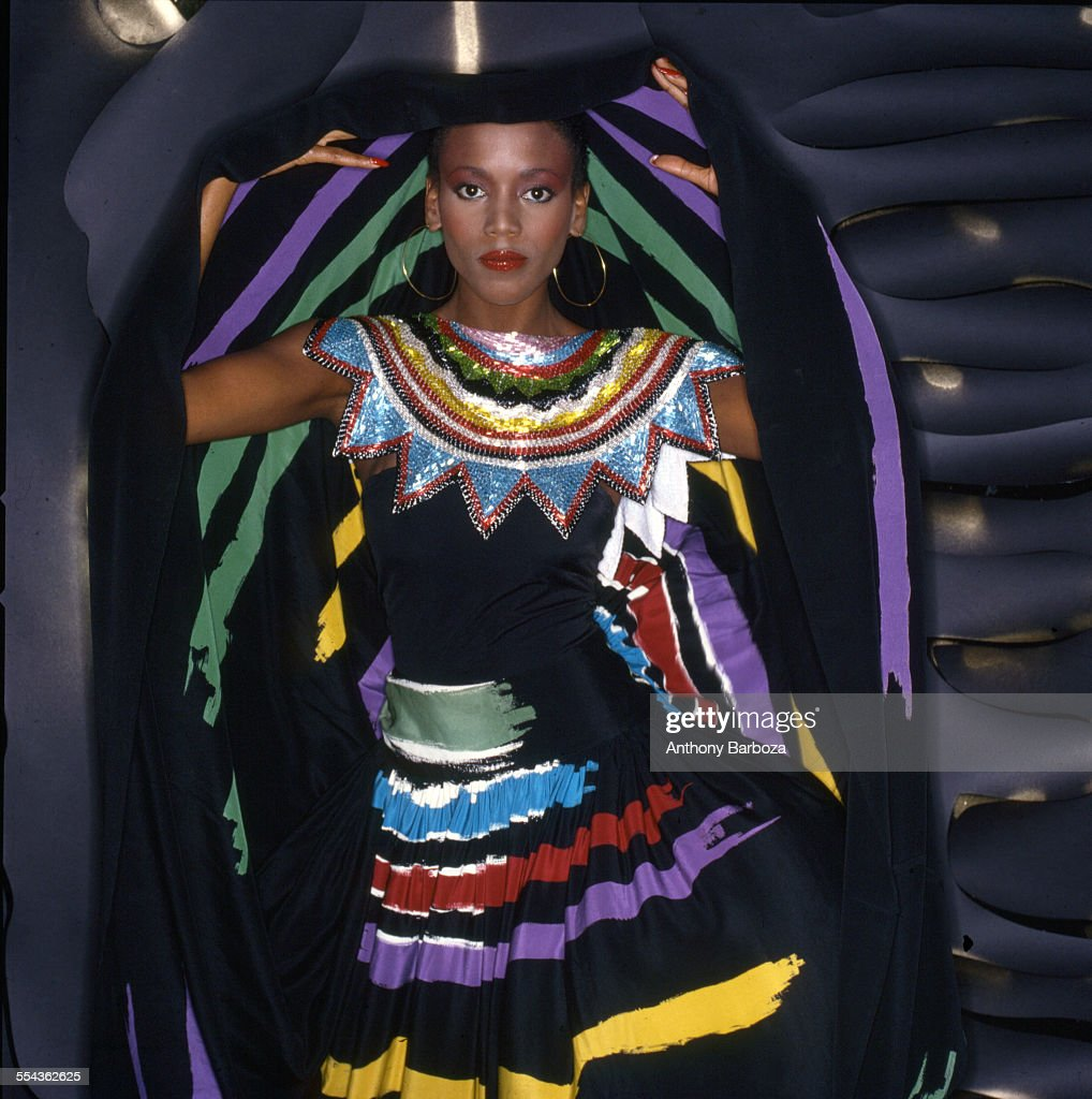 Portrait of American fashion model Toukie Smith (born Doris Smith) as she poses wrapped in a dark multi-colored robe, New York, New York, early 1980s.