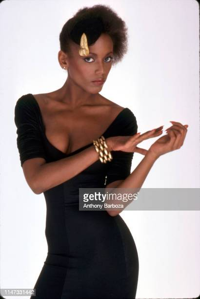 Portrait of American fashion model Toukie Smith in a black dress as she poses against a white background New York New York early 1980s