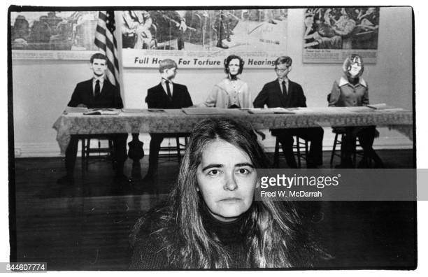 Portrait of American feminist activist author and artist Kate Millett as she poses in front of her installation 'The Trial of Sylvia Likens A...