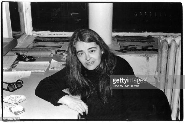 Portrait of American feminist activist author and artist Kate Millett as she sits at a desk in the Noho Gallery New York New York February 1 1978...