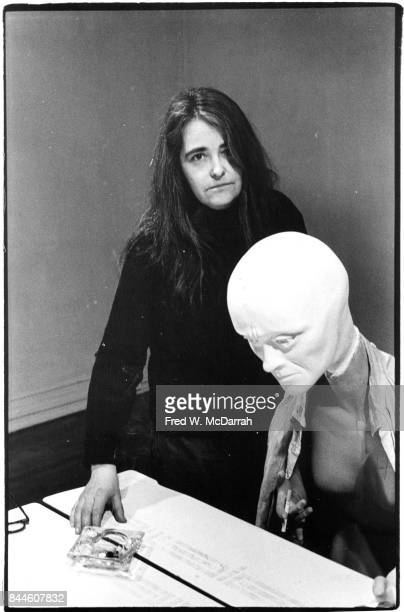 Portrait of American feminist activist author and artist Kate Millett as she poses with one of her sculptures during a show at the Noho Gallery New...