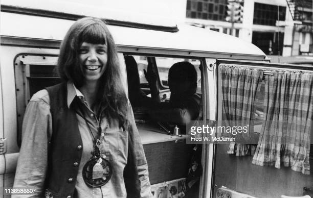 Portrait of American feminist author and cultural critic Jill Johnston as she stands beside the open door of a car New York New York October 1 1971
