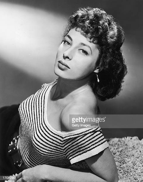 Portrait of American film actor and theater producer Rita Gam wearing an offtheshoulder stiped short sleeve sweater 1950s