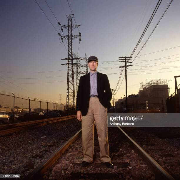 Portrait of American film and television director David Lynch as he poses on railroad tracks, Los Angeles, California, 1989.
