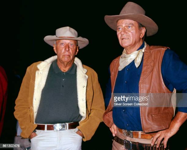 Portrait of American film director Howard Hawks and actor John Wayne on the set of their film 'El Dorado' 1967