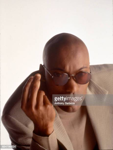 Portrait of American film director John Singleton as he poses against a white background 1992