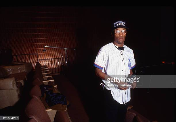 Portrait of American film director John Singleton as he poses inside a screening room Los Angeles California 1991