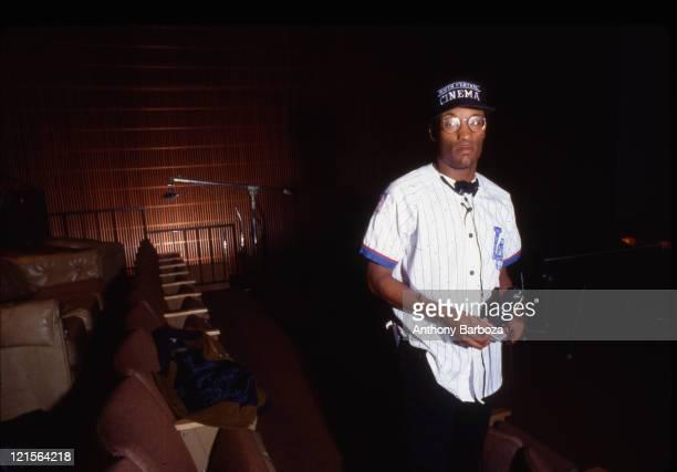Portrait of American film director John Singleton as he poses inside a screening room Los Angeles California 1991