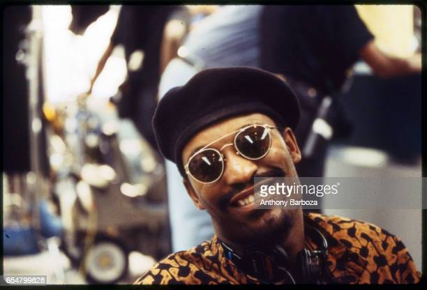 Portrait of American film director John Singleton in sunglasses and a beret as he poses on the set of his film 'Poetic Justice' Los Angeles...