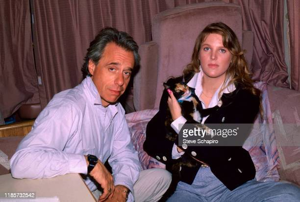 Portrait of American film director Peter Bogdanovich and Canadian teenager Louise Hoogstraten the latter of whom holds a cat Los Angeles California...
