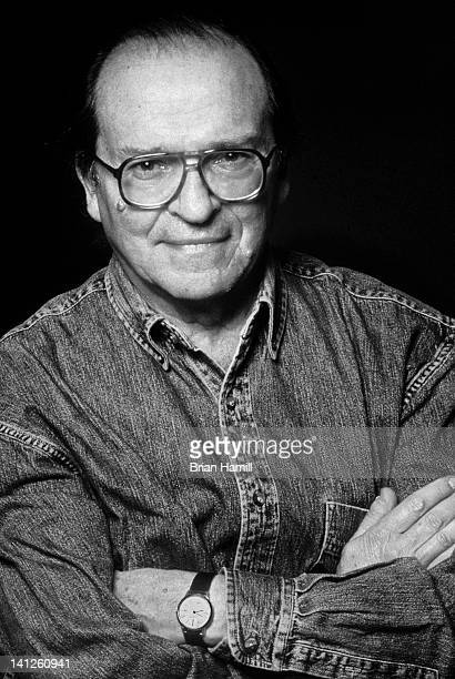 Portrait of American film director Sidney Lumet as he poses with his arms crossed in front of his chest on the set of his film 'Gloria' New York New...