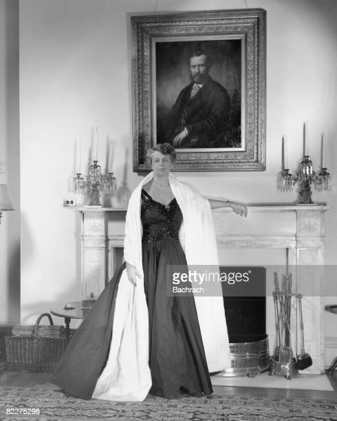 Portrait of American First Lady Eleanor Roosevelt as she stands at a fireplace in the White House Washington DC 1941