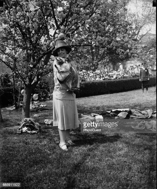 Portrait of American First Lady Grace Coolidge with her pet raccoon Rebecca during the annual White House Easter Egg Hunt Washington DC April 1927