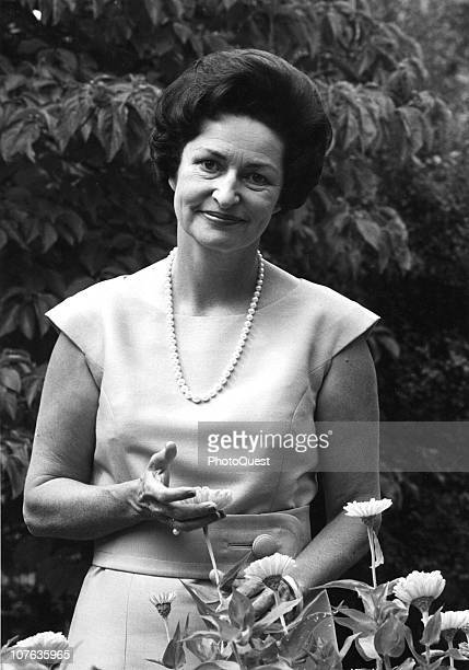 Portrait of American First Lady Lady Bird Johnson as she poses in a garden 1963