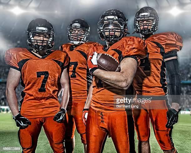 portrait of american football players in a stadium - football player stock-fotos und bilder