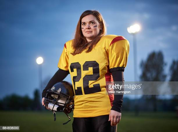 portrait of american footballer holding her helmet - safety american football player stock pictures, royalty-free photos & images