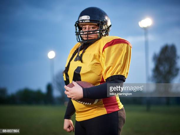 portrait of american footballer looking to camera - safety american football player stock pictures, royalty-free photos & images