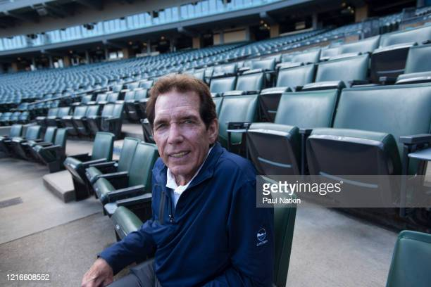 Portrait of American former baseball player AllStar pitcher and White Sox Broadcaster Ed Farmer as he sits in the stands at Comiskey Park Chicago...